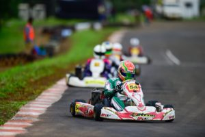 Ricky Donnison grabbed pole position in the senior max category for the championship race on sunday in the 13th JK TYRE FMSCI National Rotax Max Karting Championship,Kolhapur